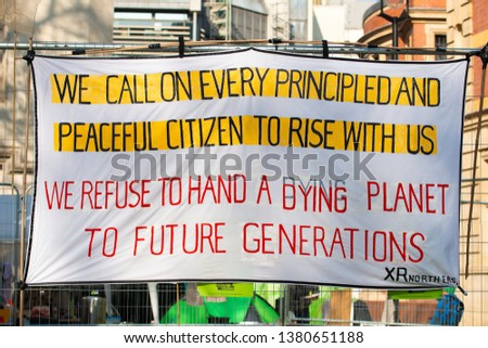 London, UK. 19th April 2019. One of the many banners seen at the Extinction Rebellion demonstration, at Parliament Square, London, in protest of world climate breakdown and ecological collapse. #1380651188