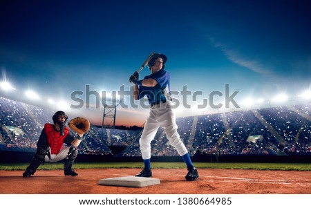 Baseball player at professional baseball stadium in evening during a game. #1380664985