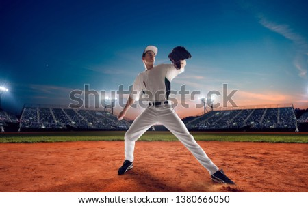 Baseball player at professional baseball stadium in evening during a game. #1380666050