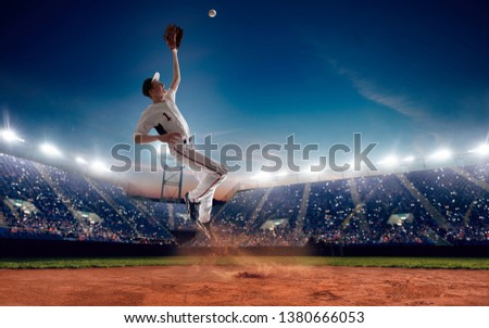 Baseball player at professional baseball stadium in evening during a game. #1380666053