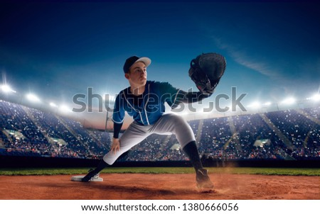 Baseball player at professional baseball stadium in evening during a game. #1380666056