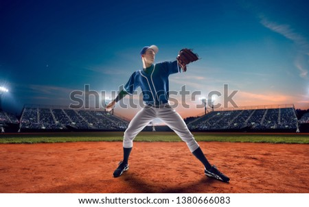 Baseball player at professional baseball stadium in evening during a game. #1380666083