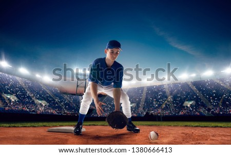 Baseball player at professional baseball stadium in evening during a game. #1380666413