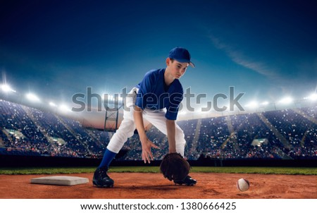 Baseball player at professional baseball stadium in evening during a game. #1380666425