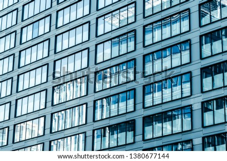 Business, city lifestyle and futuristic design concept - Contemporary office building in financial district, modern urban architecture #1380677144