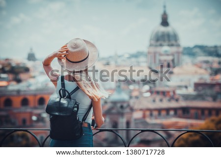 Rome Europe Italia travel summer tourism holiday vacation background -young  girl with camera in hand standing on the hill looking on the cathedral Vatican Royalty-Free Stock Photo #1380717728