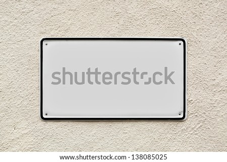 Blank sign on the wall