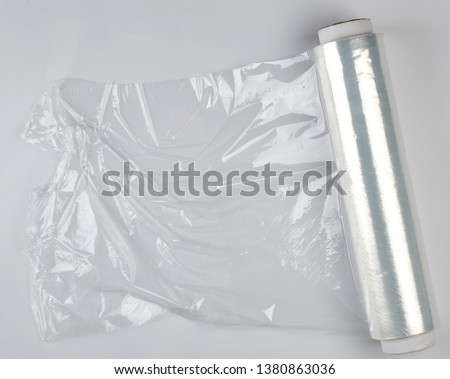 big roll of wound white transparent film for wrapping food, top view #1380863036