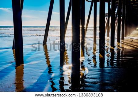 Pismo Beach, California - January 26 2019: Panorama of the town of Pismo beach and the beach in the Pacific Ocean in California #1380893108