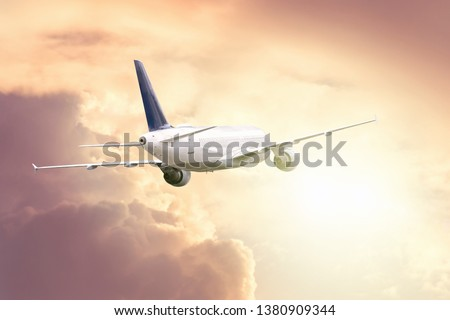 The plane flies on a journey towards the bright light in the sky #1380909344