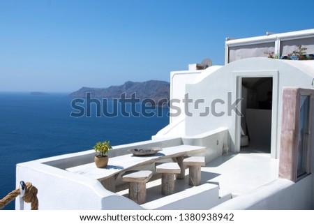 among the streets of santorini, white houses, blue sea  #1380938942
