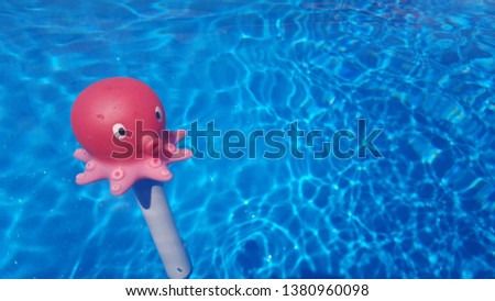 red octopus thermometer swimming in pool Royalty-Free Stock Photo #1380960098