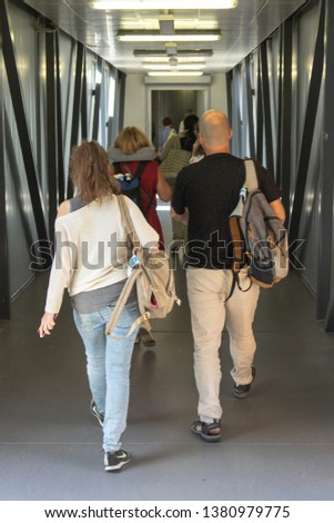 Russia, Moscow, August 2018: The people going at corridor inside the telescopic gangway #1380979775