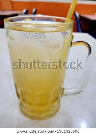 """Orange juice beverage, known as """"Es Jeruk"""" in indonesian #1381023506"""