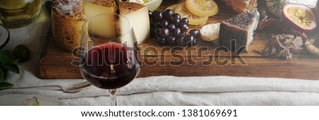 Platter of cheese with seasonal fruits and wine #1381069691