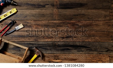 Empty chalkboard with many handy tools, on wooden background top view with copy space for text, Labor day background #1381084280