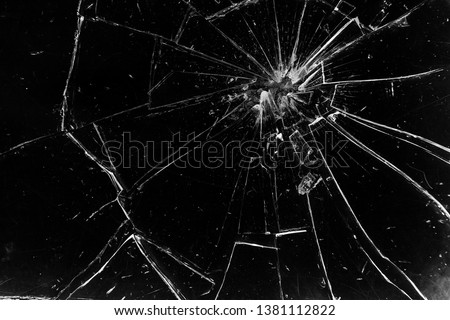 Cracks in the glass on a black background. Abstraction #1381112822
