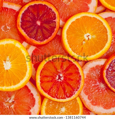 Different kinds of oranges and grapefruit slices background #1381160744