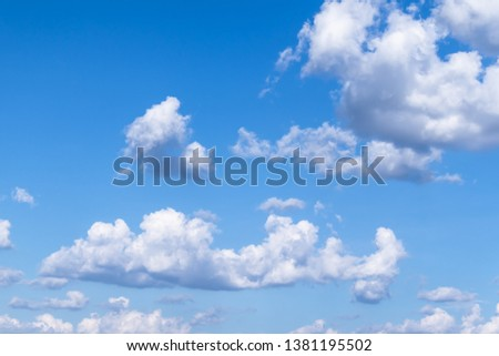 Blue sky with beautiful white clouds Royalty-Free Stock Photo #1381195502