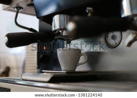 perfect espresso shot with the espresso machine in the espresso bar #1381224140