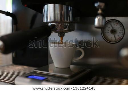 perfect espresso shot with the espresso machine in the espresso bar #1381224143