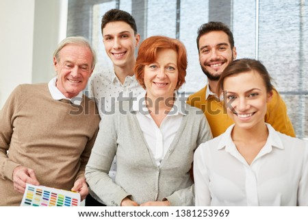 Creative team with senior businessman and young business people #1381253969