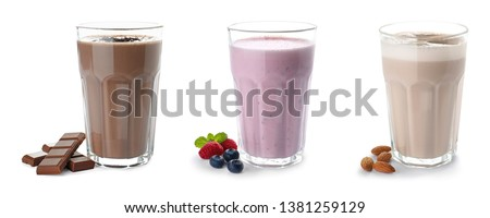Set of glasses with delicious protein shakes on white background #1381259129
