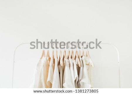 Feminine clothes on hanger. Minimal fashion composition on white background. #1381273805