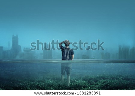 A boy observes a city in a world submerged by water. Global warming, melting of arctic ices or Great Flood concept. #1381283891