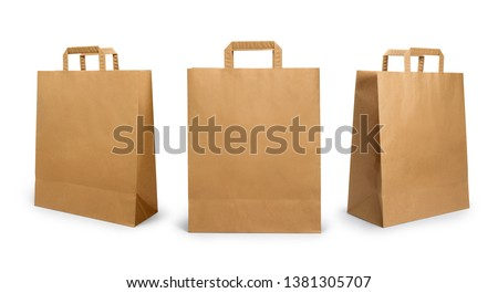 Folded paper bag with handle isolated on white background Royalty-Free Stock Photo #1381305707