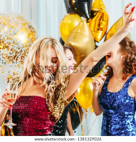 Fancy party. Blonde lady celebrating with maids of honor her upcoming special day. Girls dancing, having fun together. #1381329026