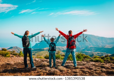happy family-mom, dad and son-travel in nature #1381390538