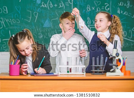 childrens day. Chemistry. Back to school. Little kids learning chemistry in school lab. Little children at school lesson. students doing biology experiments with microscope. Stressed and tired doctor. #1381510832