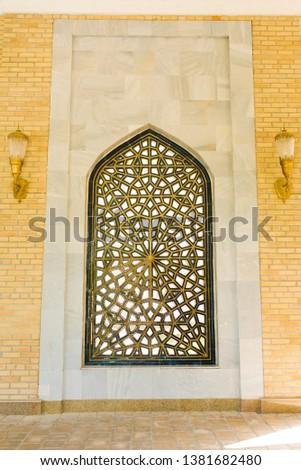 Samarkand, Uzbekistan. April 2019. Eastern patterned lattice on the window #1381682480