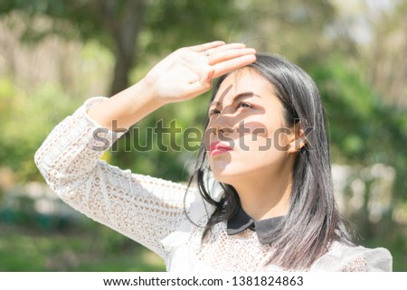 Woman is protect sun light on the summer outdoor #1381824863