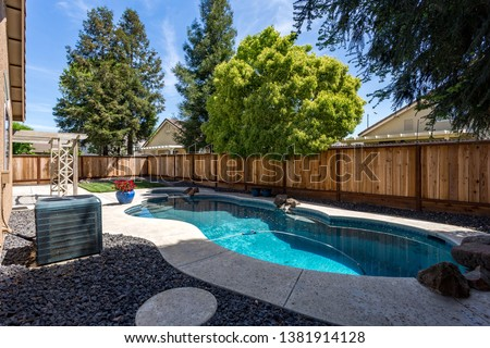 Exterior Backyard with Pool and Hot Tub in a neighborhood #1381914128