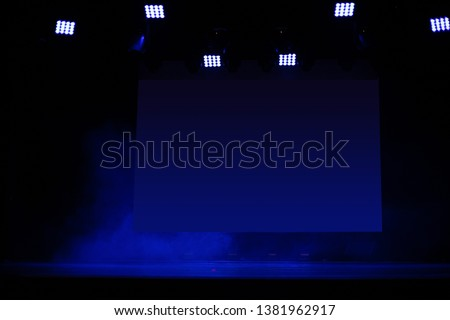 Theatrical scene without actors, scenic light and smoke #1381962917