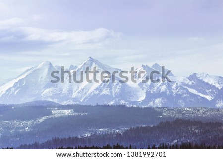 Snowy mountaing peaks  of Tatra Mountains #1381992701