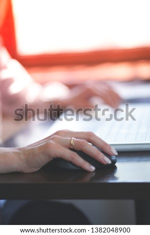 Woman working with laptop in coffee house #1382048900