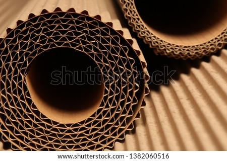 corrugated cardboard texture and product for advertising and design Royalty-Free Stock Photo #1382060516