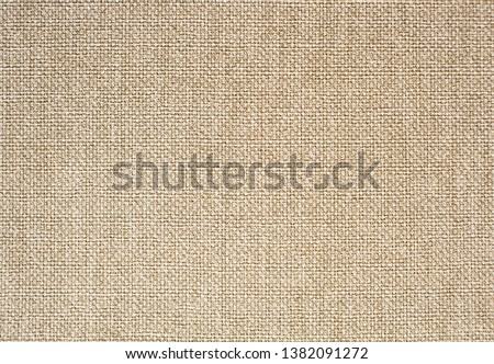 textured beige burlap wallpaper close up