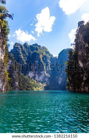 Chiewlarn, Ratchaprapa Dam in Khao Sok National Park. Beautiful nature of Asia at Suratthani Province,Thailand - Travel and Holiday getaway Concept Background  #1382216150