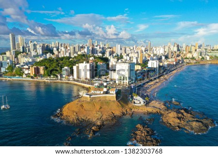SALVADOR, BAHIA, BRAZIL - MAR 8, 2019: Aerial drone view of Salvador da Bahia cityscape, Barra and lighthouse. #1382303768