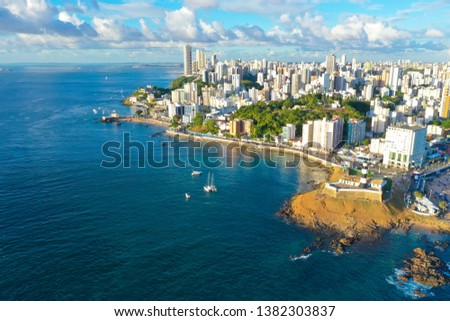 SALVADOR, BAHIA, BRAZIL - MAR 8, 2019: Aerial drone view of Salvador da Bahia cityscape, Barra and lighthouse. #1382303837