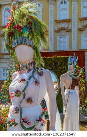 TIMISOARA, ROMANIA - APRIL 20, 2019: Beautiful floral decoration with statues symbolizing ancient goddesses in Union Square on the occasion of the Flower Festival organized by the City Hall. #1382371649