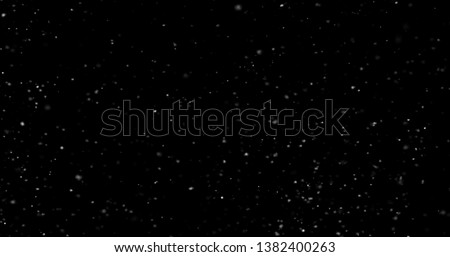 Flying dust particles on a black background #1382400263