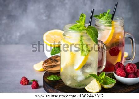 Lemonade. Two lemonades - classic and raspberry in mason jars. Close up. #1382442317