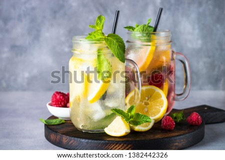 Lemonade. Two lemonades - classic and strawberrry in mason jars with ingredients. Close up. #1382442326
