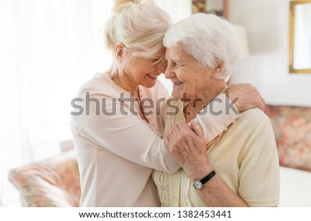Senior woman spending quality time with her daughter #1382453441