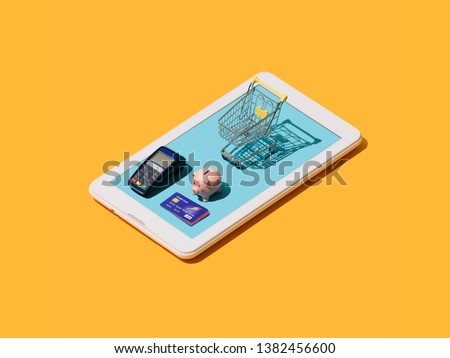 Online shopping and electronic payments app: shopping cart, POS terminal, piggy bank and credit cards on a touch screen smartphone #1382456600